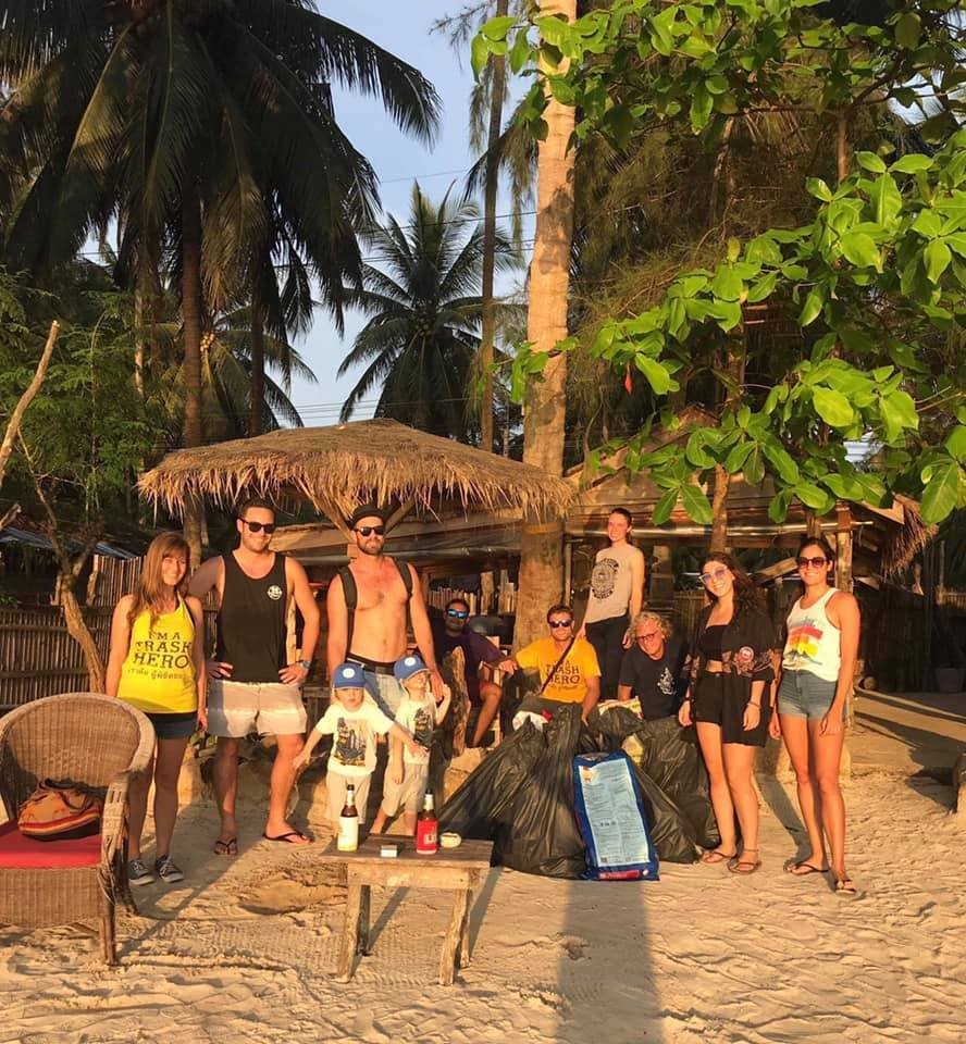 group photo clearing up rubbish on the beach