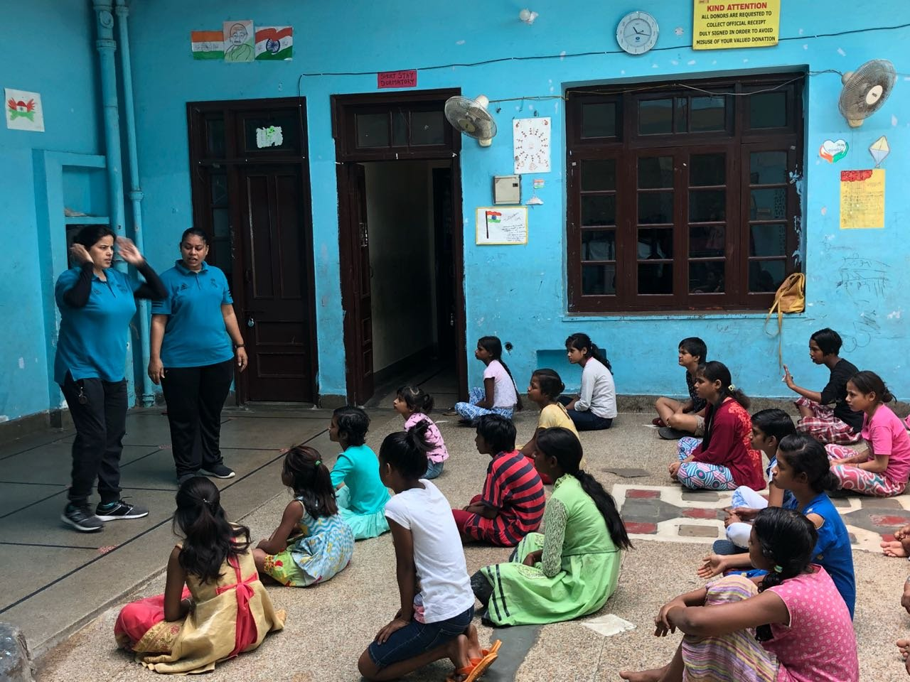 Children being taught at a charity centre in India