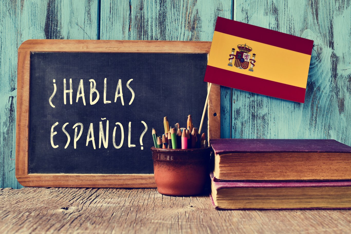 Chalkboard with Spanish words 'Hablas Espanol?'