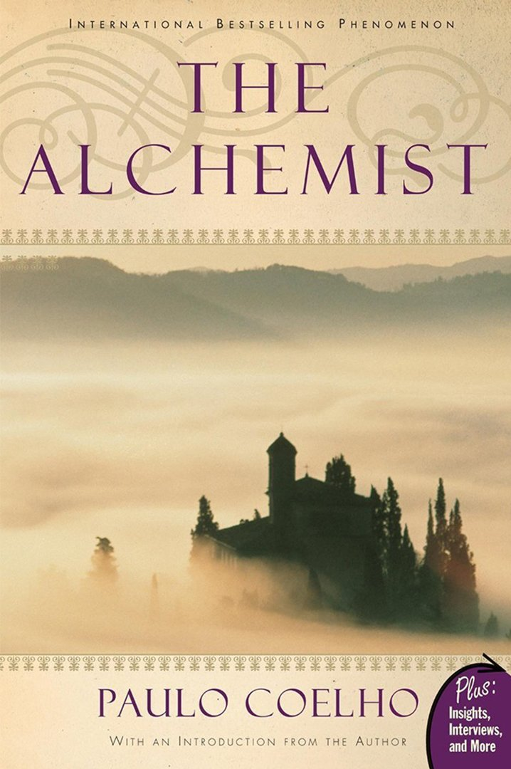 The alchemist book cover - misty sky with building in the distance