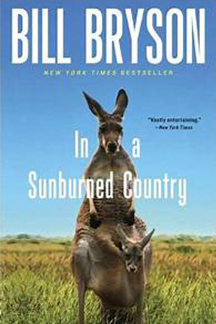 In a sunburned country book cover with blue sky and kangaroo hoping in background