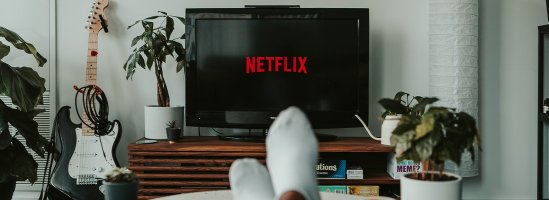 Person sitting with Feet up Watching Netflix on TV