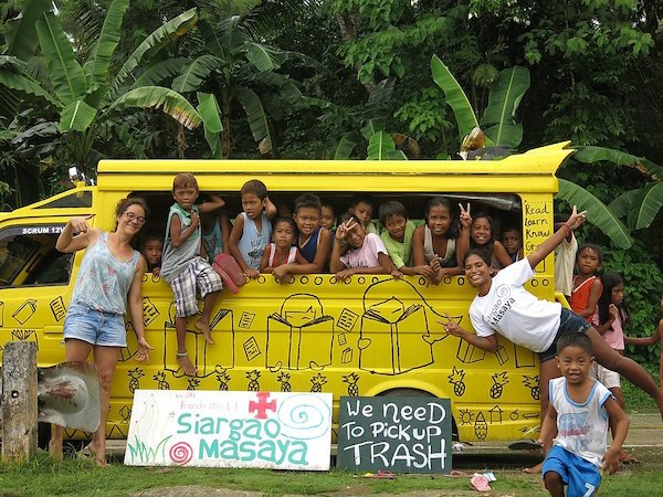 Siargao Masaya  - local children in van with 'picking up trash' sign