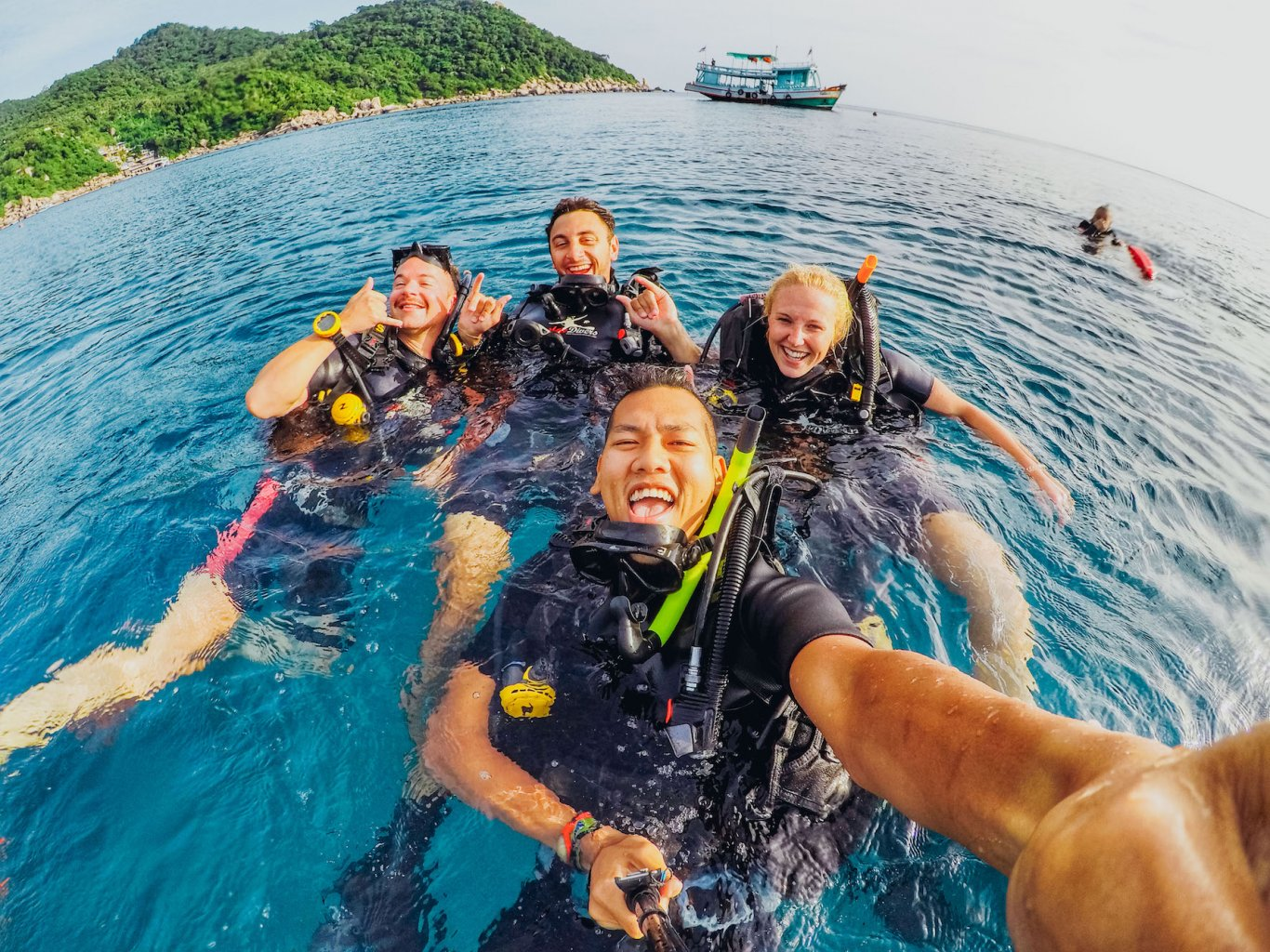 group of friends scuba diving - Borneo