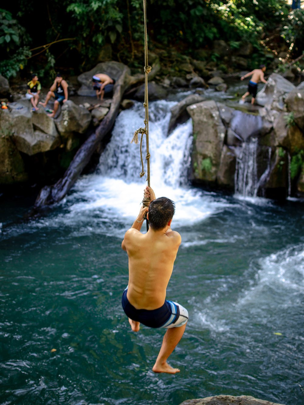 rope swing into waterfall - la fortuna