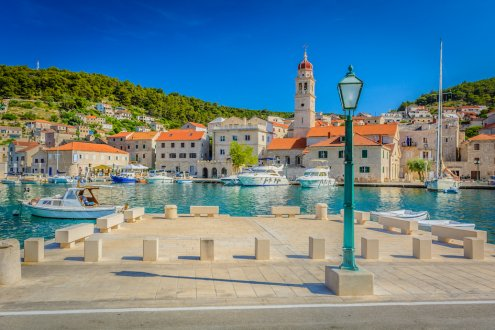 The picturesque island of Brac, Croatia with clear blue water and scenic houses along the waterfront