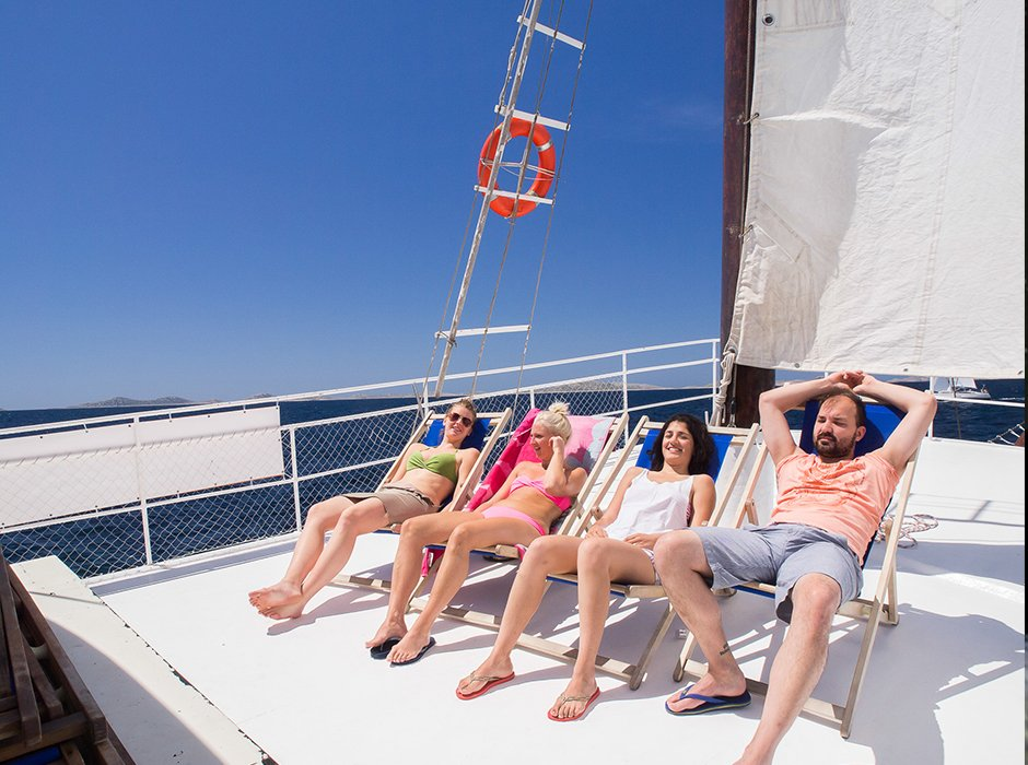 A group of four on the yacht in Croatia, enjoying the sun