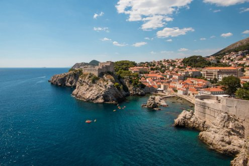 A photo from the sea wall of Dubrovnik, Croatia showing the clear and deep blue sea and amazing cliff formations