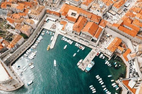 A birds eye view of Dubrovnik, Croatia showing the marina and the terracotta houses