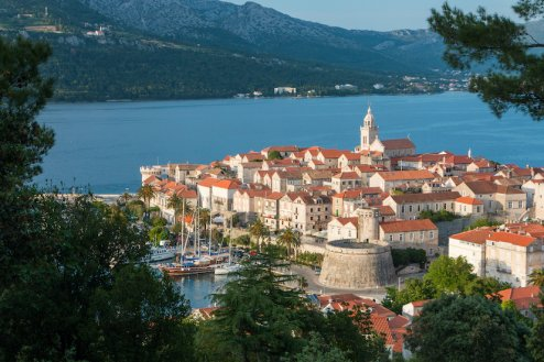 The island of Korcula in Croatia showing the blue sea, green landscape and terracotta houses