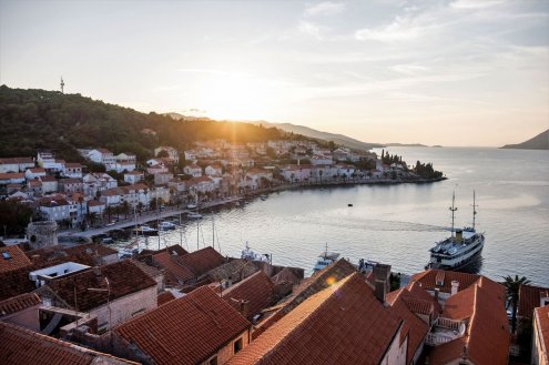 The island of Korcula, Croatia at sunset with houses and boats in view