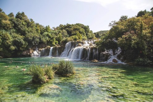 A scenic photo of the stunning waterfall in Krka National park in Croatia