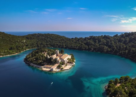 A stunning shot of Mljet, Croatia's National park with clear turquoise water and lush greenery  at sunset