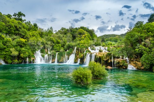 The stunning waterfalls in Plitvice Lakes, showing the luscious greenery and the bright turquoise water