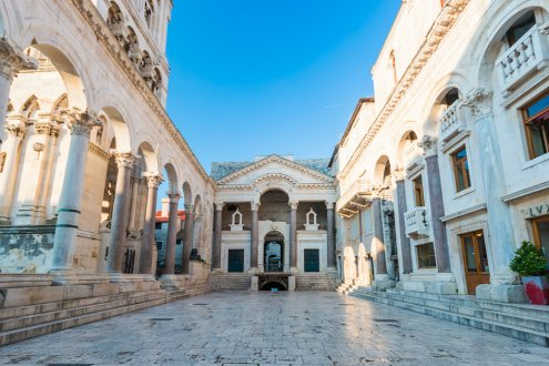 Gorgeous white architecture in Split, Croatia showing a bright blue sky
