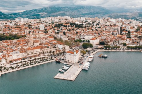 Aerial view of Split, Croatia showing the port, beautiful mountain landscape and the terracotta roofs of Split