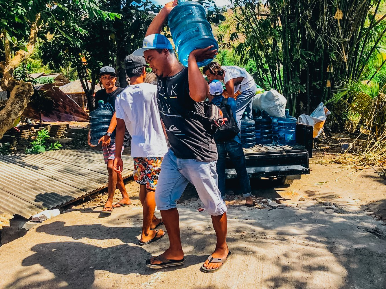 loading food into van to help the locals of lombok