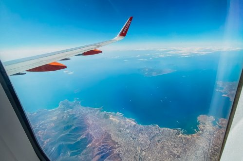A view of the amazing landscape and sea of Greece from the plane