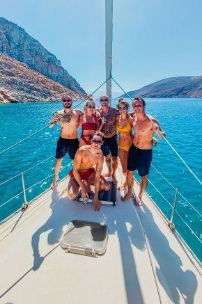 A group of 6 on the sail boat while sailing around the stunning Greek islands