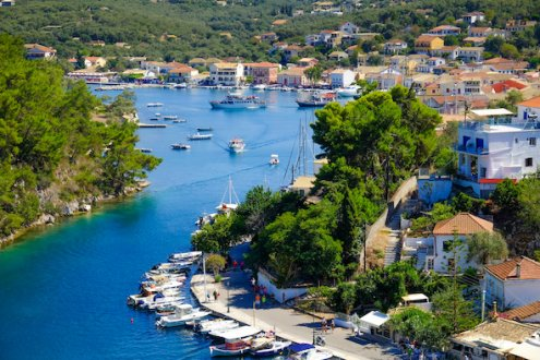 An aerial view of the town Lakka, in Paxos Greece with boats on the water