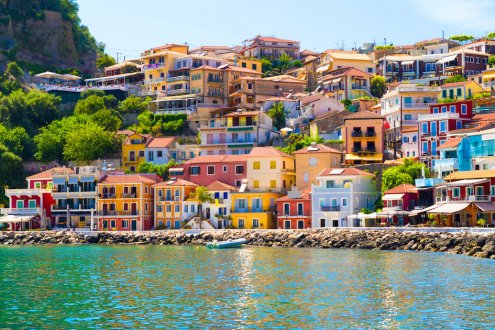 A gorgeous photo of the different bright coloured houses right by the waterfront in Syvota Greece