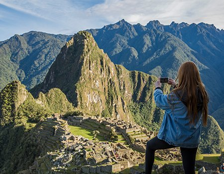 Machu Picchu, Peru. Tourist walking around to explore the wonder of the world