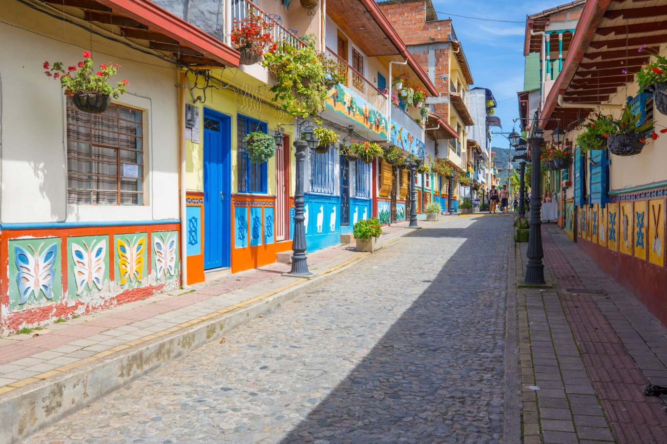 View of colourful street in Colombia with cobbled floor