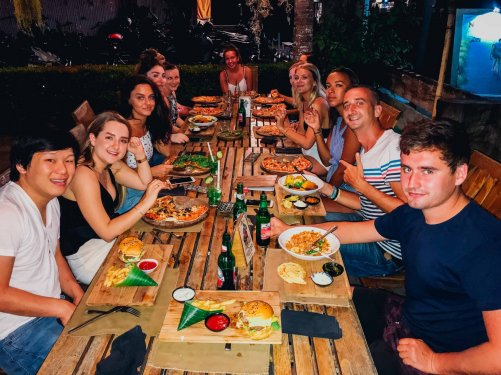 Group of travellers having dinner in Bali
