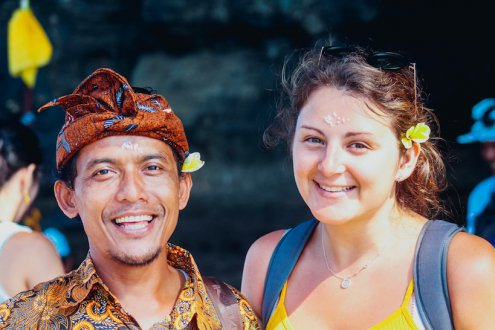 Girl with local Bali man smiling
