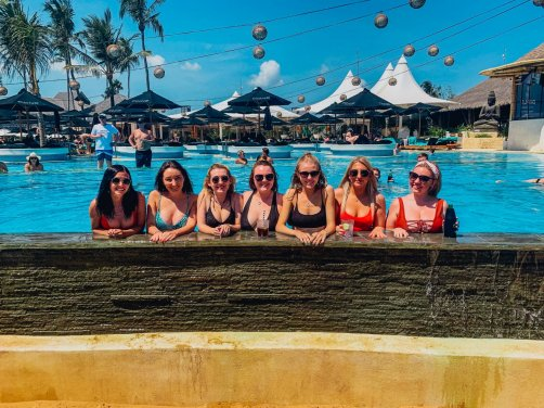 A group of girls in the pool at finns beach club in Bali Indonesia