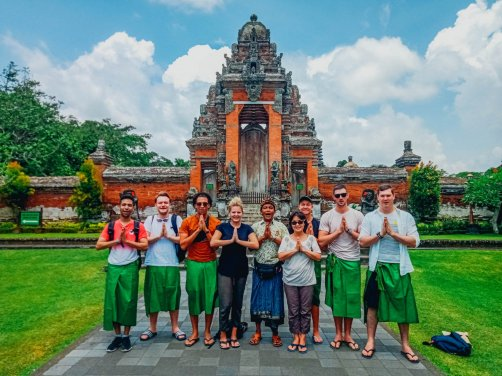 A group at the temple Taman Ayun in Bali Indonesia