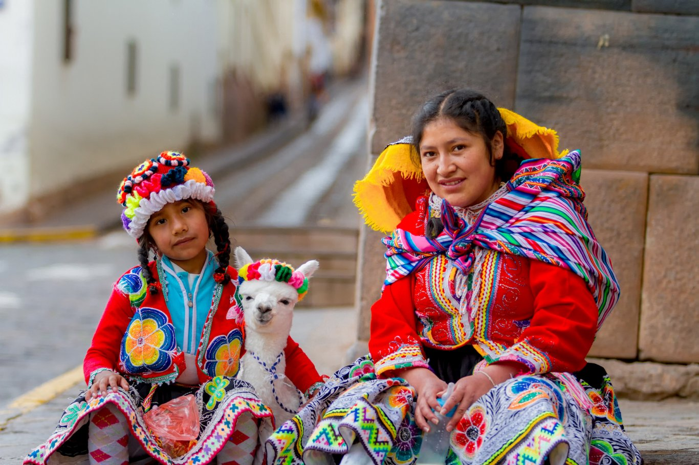 Local Peruvian family with Llama adorned in traditional Peruvian dress