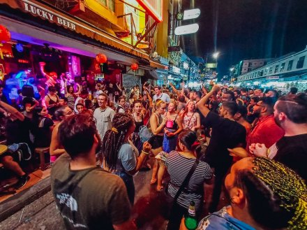 A lively photo of a crowd enjoying the nightlife in Bangkok