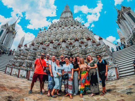 group standing in front of temple in Bangkok