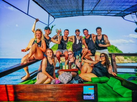 A group photo on a boat with a few chang beers in Koh Phangan Thailand