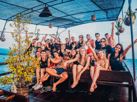 A fun group photo on a boat in Koh Phangan Thailand