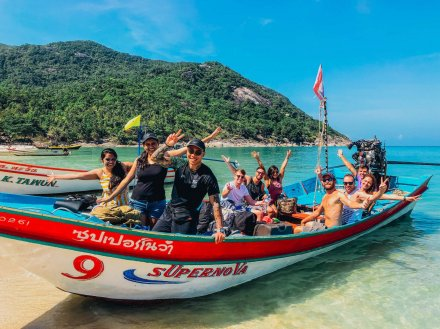 A group photo on a speed boat at bottle beach in Koh Phangan Thailand