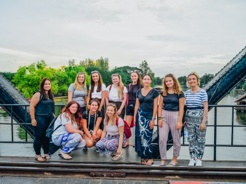 Group of girls on the bridge over River Kwai