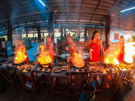 Creating flames from the wok in a cooking class in Chiang Mai Thailand
