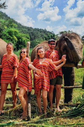 A group hanging out with the elephants at the sanctuary in Chiang Mai Thailand