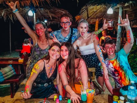 A group getting ready with paint at the full moon party in Koh Phangan Thailand