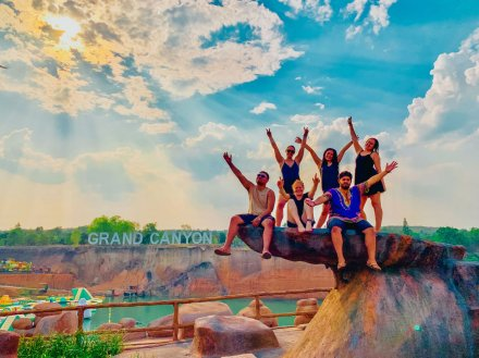 Group sitting on rock outside the Grand Canyon waterpark in Chiang Mai, Thailand