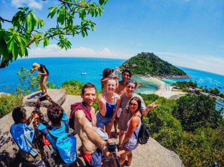 group taking selfie at Koh Nang Yuan with islands in distance and blue water and sky