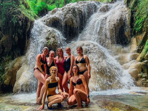A group of girls in front of Erawan waterfall