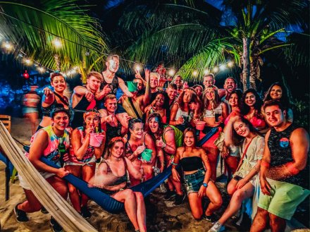 A group photo at the full moon party in Koh Phangan Thailand