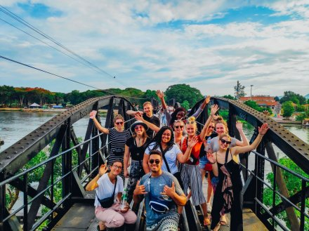 A happy group photo at the idyllic bridge on river Kwai