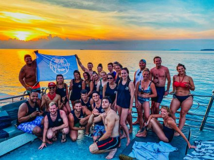 A group photo in front of the serene sunset in Koh Phangan