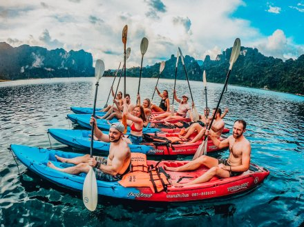 Group kayaking in Khao Sok Thailand with picturesque scenes