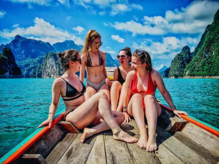 A group of four girls enjoying a boat trip at Khao Sok National Park