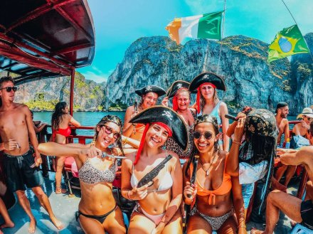 Girls on a boat party wearing pirate hats while Island hopping in Koh Phi Phi Thailand